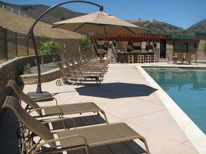 This is the pool area of a ''Off Grid'' corporate retreat. This concrete was laid upon a 10'' bed of class 2 base with a vapor barrier installed beneath the base material to minimize the infiltration of water. This was done in order to minimize the expansion in the clay based soils. The diamond shaped expansion joints are filled with a electrometric material to assist in minimizing surface penetration of rain and pool water through the concrete.