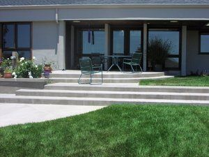 Split level concrete steps and patio with integral color.