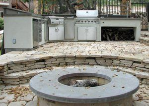 Small fire pit that was formed and poured. The cap is poured in place concrete with a smooth toweled finish that cantilever both inside and outside.