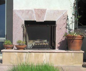 Outdoor fireplace with a flagstone trim and hearth that was hand cut on site. All cuts were hammered and textured to eliminate all visible saw cuts and provide a natural appearing edge.