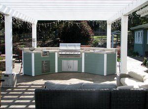 Steel framed with tongue and groove cedar siding. All the cedar had to be predrilled and then fasten to the steel framing with self tapping screws. The gas grill is propane fueled with electronic ignition. There is a dual burner on the left side which is also tied into the propane supply line of the house, eliminating the need for 5 gal. propane tanks. There is also a warming tray built into the right side counter top. The counter is ceramic tile with a stone imprint to carry over the texture stamped into the concrete deck.