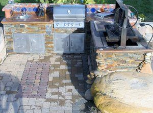 Permeable paving featured in the outdoor kitchen area.