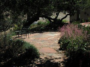 River washed Sedona red flagstone as described in A3 of Arbors, Decks and Hardscapes