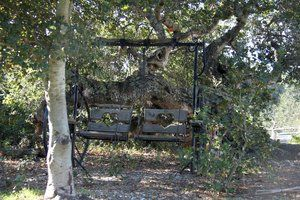 Swinging seating. Fabricated from steel found on the ranch and welded into a swinging love seat for two.