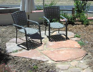 Simple flagstone pad constructed from River washed Sedona red flagstone.