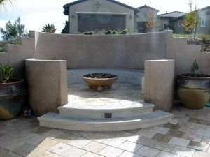 Firebowl area showing the close proximity of neighboring home. Once inside the seating area the neighboring structure is out of sight due to the raised wall.