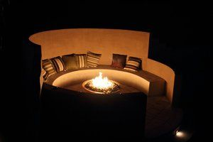 Natural gas fueled fire bowl casts a warm glow throughout the enclosed conversation pit.