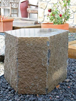 Basalt column with polished surface. This material we use in our pondless waterfeatures by coring out a 3/4'' section the length of the basalt and plumbing with a return line from a subterranean vault that houses a small submersible pump.