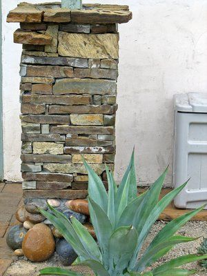 Dry stack stone column at succulent garden