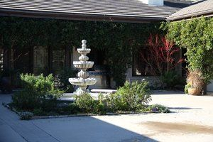 Courtyard centerpiece featuring a three tiered fountain with pond. Constant maintenance but looks great to those who do not need to maintain it. Coral barked Japanese Maple featured in back right hand corner of court yard.