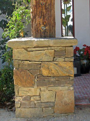 Lincoln pencil rock mortared to a concrete footing.