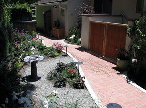 Clay brick walkway with a precast white cement trim piece that was 6'' in thickness. Each trim pc. had to be cut into 3'' thick pieces to match the clay brick dimension. All was grouted in a sanded, natural gray, grout to match the existing brick landing in front of the pool equipment vault.