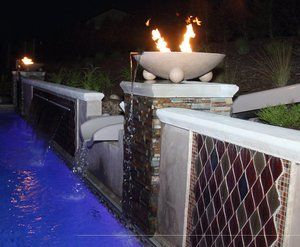 Dual fire & water bowls mounted atop poured in place, white portland cement caps.
