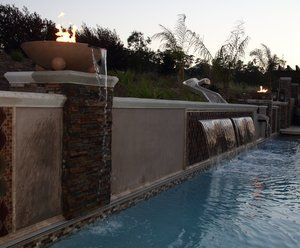 The area necessitated a wall in order to squeeze the pool in. In order to maximize the backyard environment we used the wall to support a number  of elements that could not had otherwise been used.