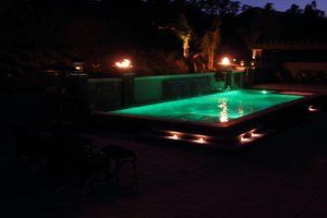 Programable LED pool lighting  turns the water from blue to turquoise.