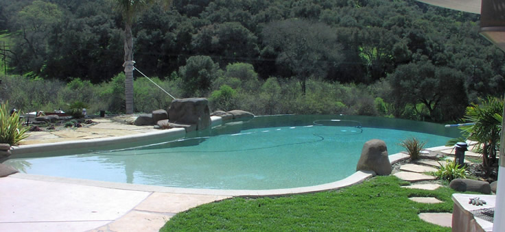 Vanishing edge pool with beach entry...